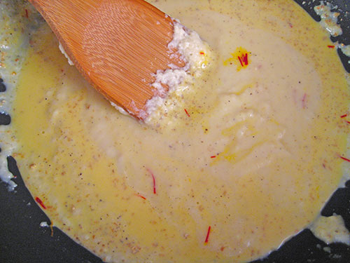 Add saffron milk and cardamom powder in khoya