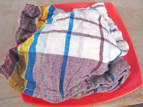 Covered dough with damp cloth