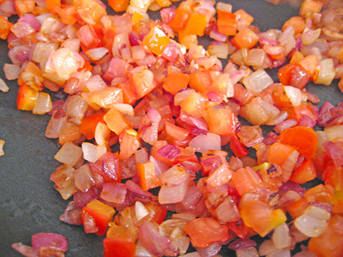 Adding tomato and cooking with onion