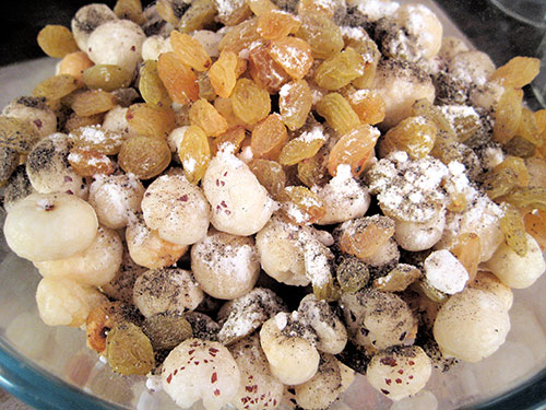 Mixing of all the dry fruits and spices in a bowl