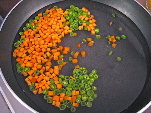 Boiling of french beans and carrots