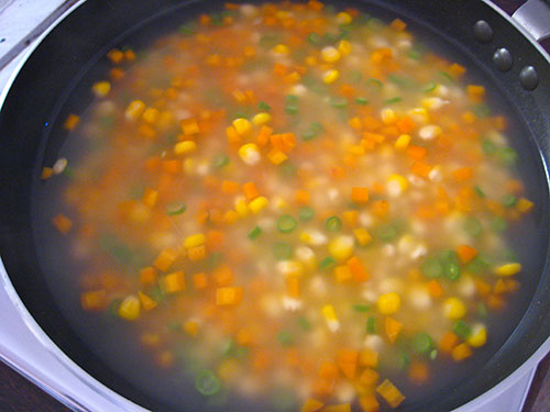 Adding of corn flour solution into soup