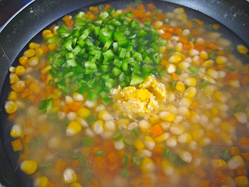 Adding of mashed corn and chopped capsicum