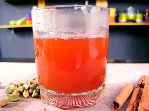 Combination Of Cinnamon Powder, Cardamom Seeds And Water